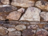 Rock wall side of old rustic building at the Vulture Mine tour